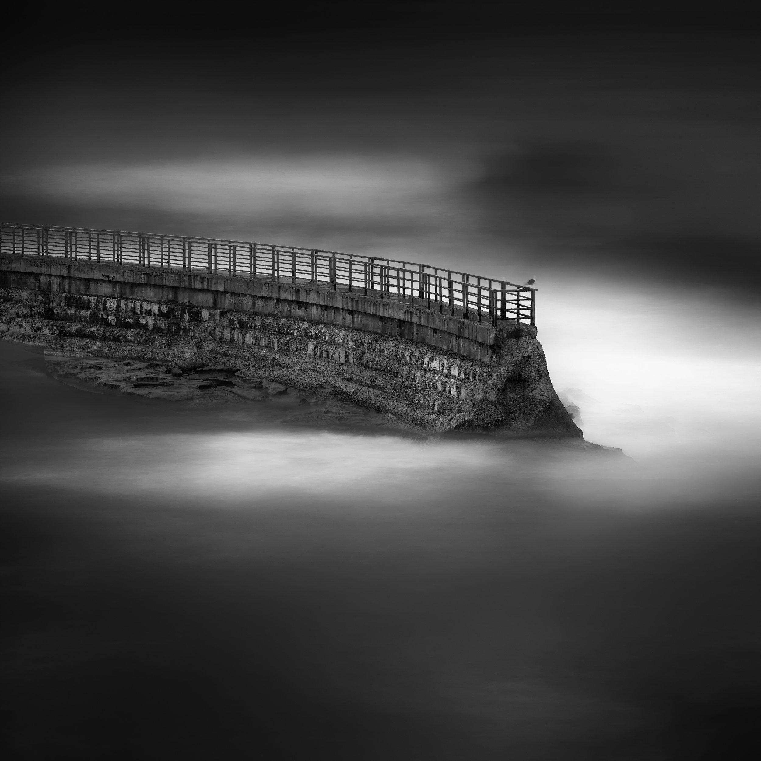 La Jolla black white children pool wall waves void dark moody