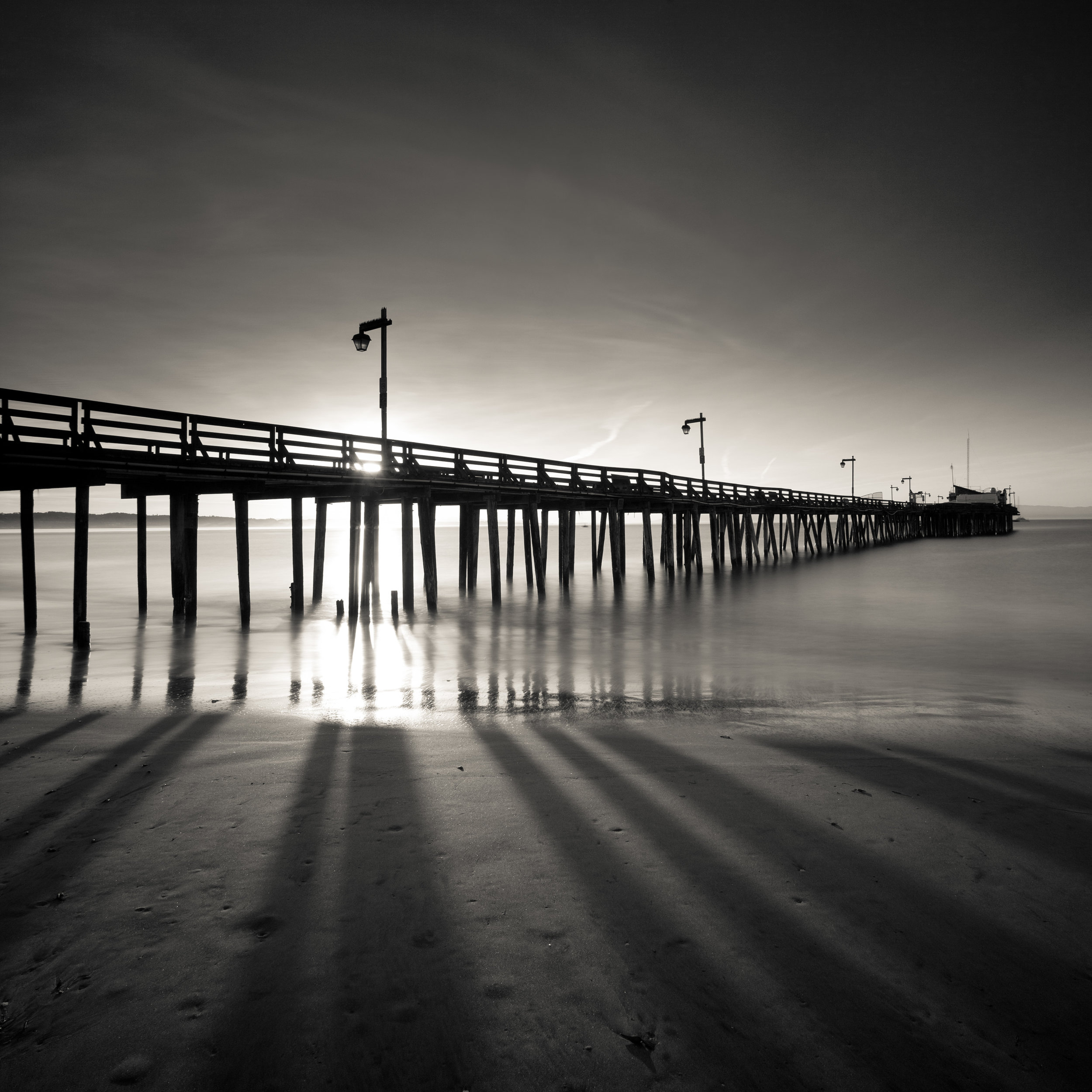 Capitola black white sunrise pier morning shadows beach