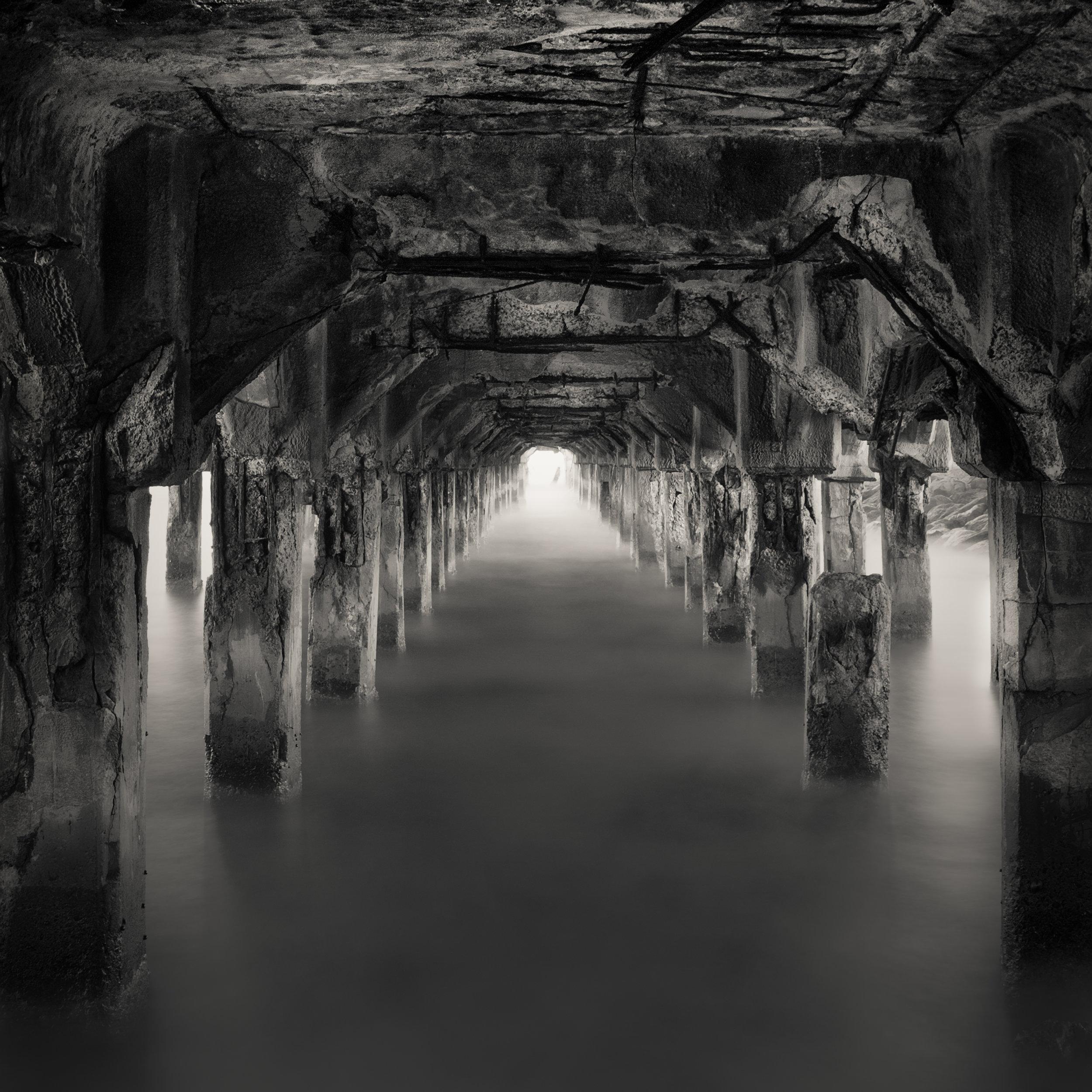 Maui Lahaina black white pier remains underneath catacombs