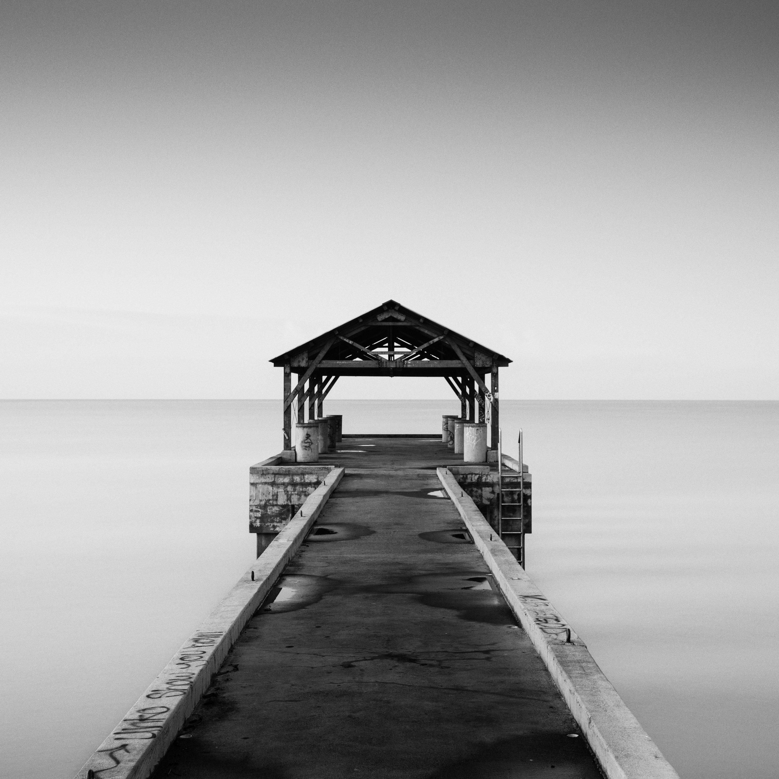 Kauai Waimea black white pier hut