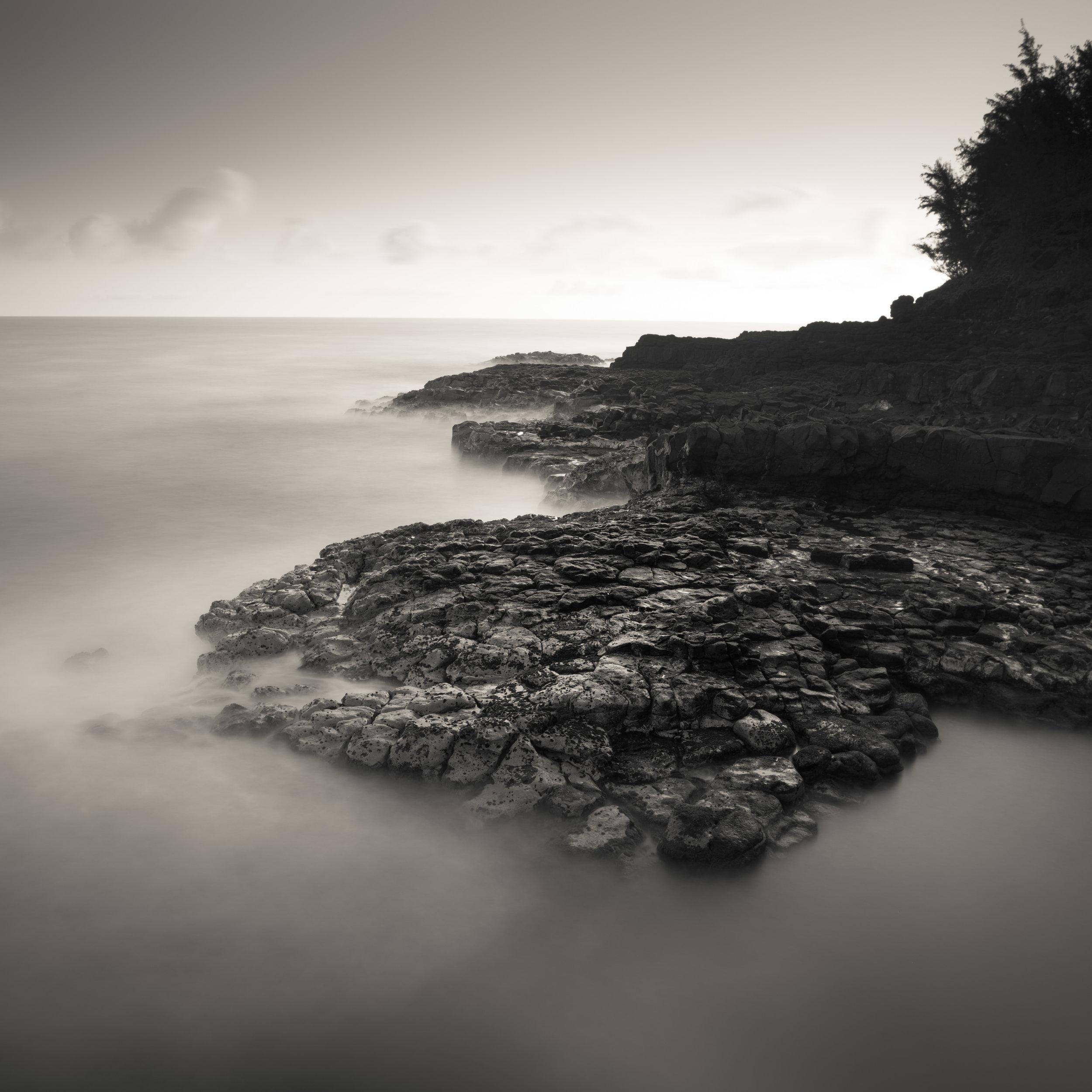 Kauai black white queens bath sunrise hard rocky beach