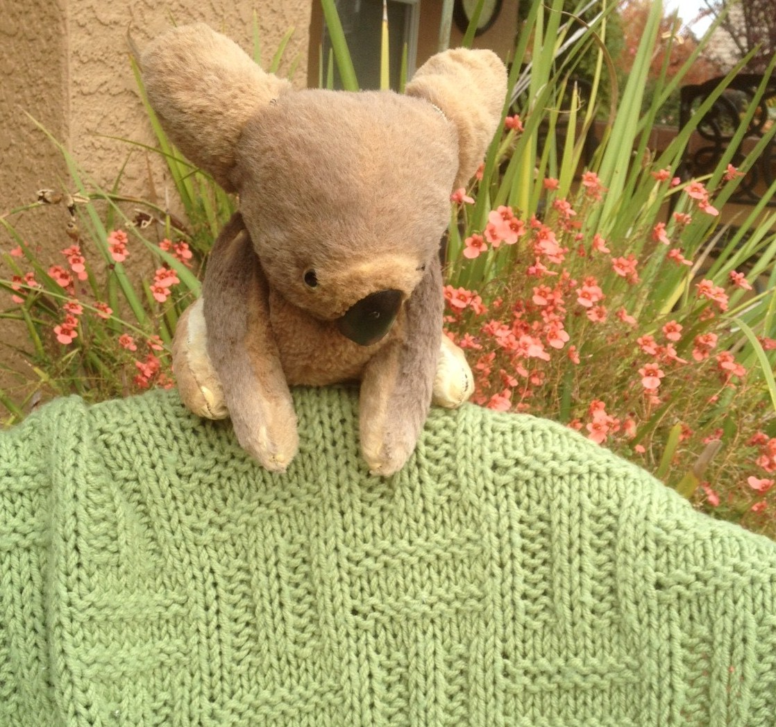 This is the blanket that I knit for my mom when she was first diagnosed. Sitting on the blanket is her koala bear. Her oldest brother gave her this treasured keepsake when he was living in Australia. I believe my mom was in her teens or early 20's. She had him for at least 50 years!