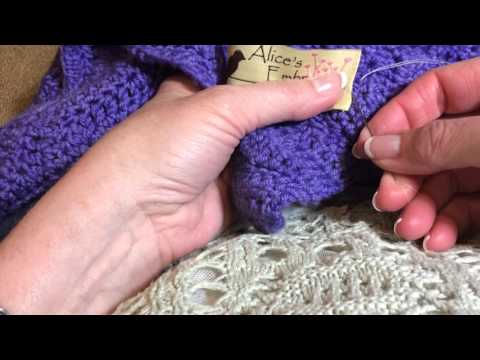 Click the above picture to see a tutorial for sewing on one of our unique Alice's Embrace labels. We have sewn on hundreds, so we thought we would share our method of sewing a label on a knitted item. It is not a professional video, just Diane showing you how she does it and thought you would like to see her method that works nicely.