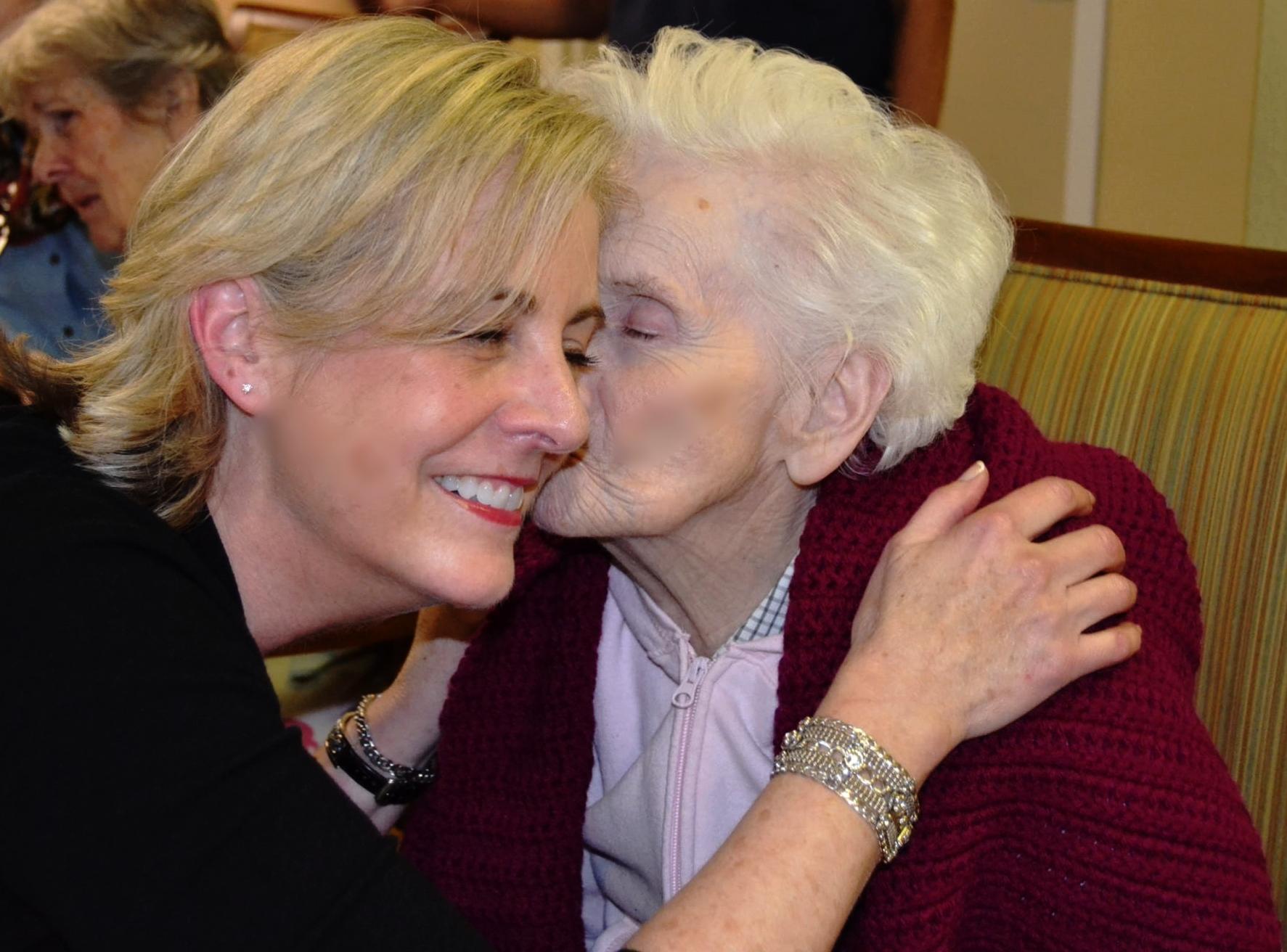 AE - Brookdale Roseville Louise giving Diane kiss.JPG