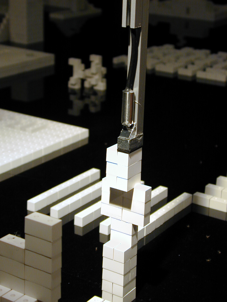 """TeleZone was a collaborativ telerobotic installation and game on display in the Ars Electronica Center from 1999 on.A robot at the ars electronica center acted as """"interface"""" between real and virtual space. Representing the user, it arranged and sticked together the building blocks on theTeleZone site precisely in accordance with the respective planning input.  In 2000, the telezone team won an Award of Distinction at the Prix Ars Electronica in the category ».net«. Learn more about TeleZone at the Prix-Page."""