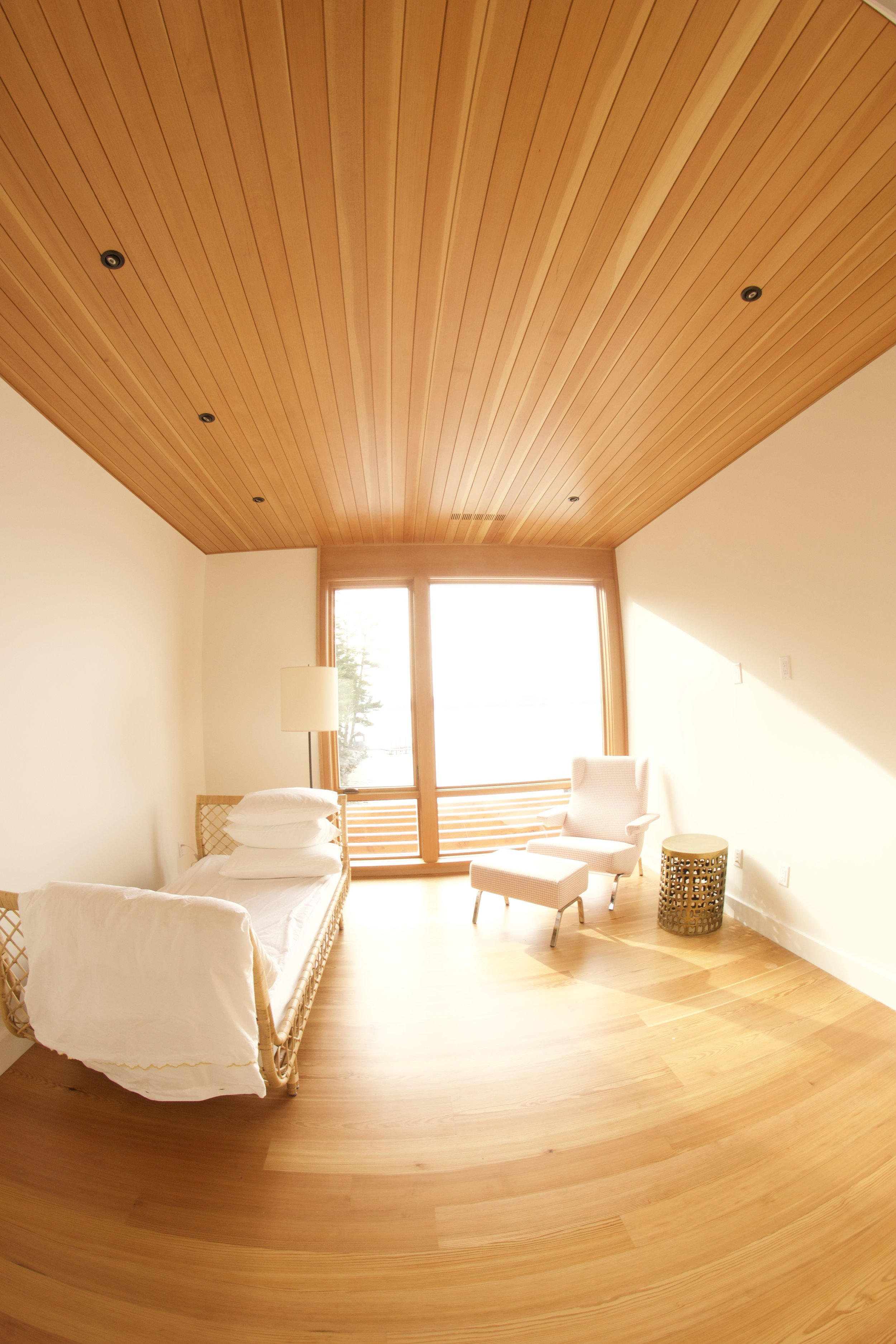 Sun room composed of clear vertical grained Douglas fir and old growth pine flooring. Finishes are 13% sheen at 90 degrees.