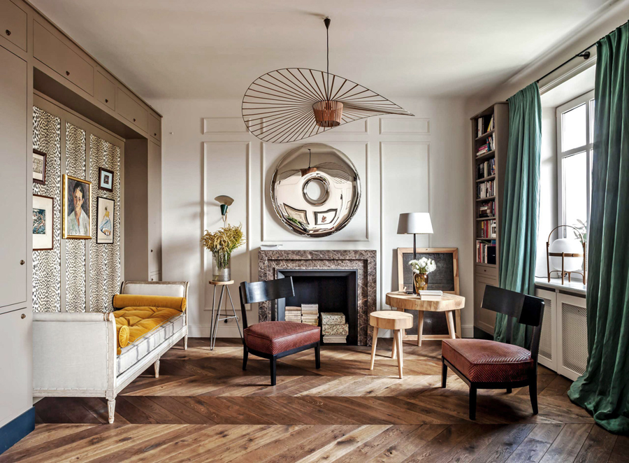 An international lawyer from France moved to Poland and enlisted Marta Chrapka of Polish design studio,  Colombe Design , to add a little Parisian flair to the flat -- here are the chic, chic results, including chevron flooring, dramatic chandeliers and a leopard print wall . . .