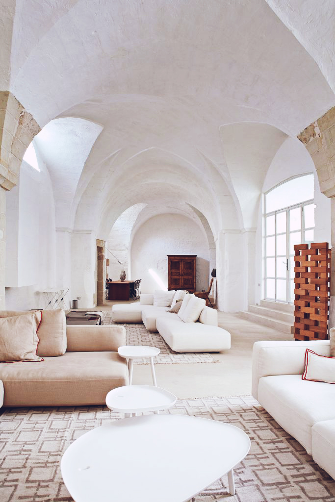 The country home of Italians,Ludovica and Roberto Palomba, of the Milan-based architecture firm  Palomba Serafini Associati was once an oil mill. The couple decided not to add any new walls to the 17th-century space, opting to keep it as close to the original as possible, which included keeping the stone flooring. The biggest change to the home was the addition of multiple skylights, which opened up the space, giving it an airy, bright quality perfect for an Italian country home . . .