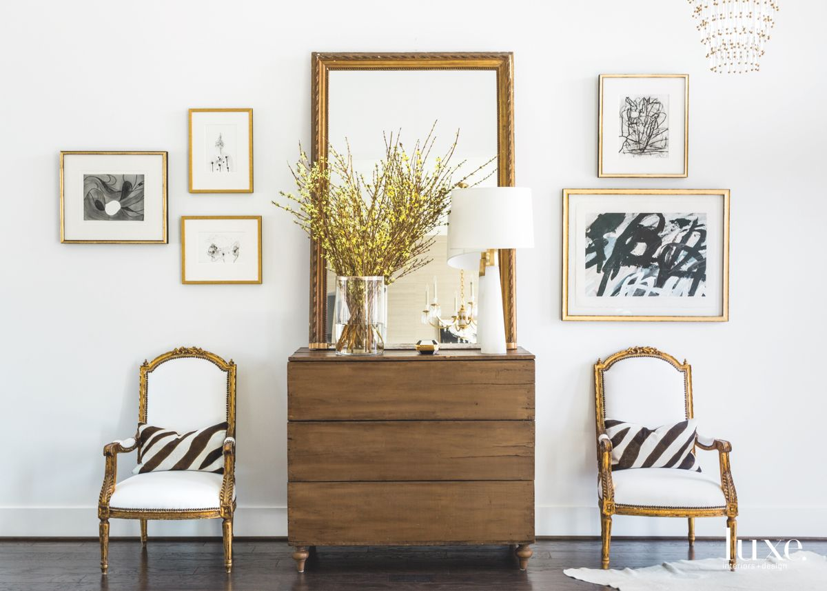 """Houston-based interior designer  Paloma Contreras  worked on the design for this Katy, Texas home with her client for over two years. The client already had a strong vision for the place that included """"a high-contrasting black-and-white palette punctuated by graphic patterns, gold accents and modern yet sophisticated finishes"""". As a longtime follower of Contreras'blog, she knew the designer would be the right person to help her take things to the next level and challenge her to make bolder decisions ..."""