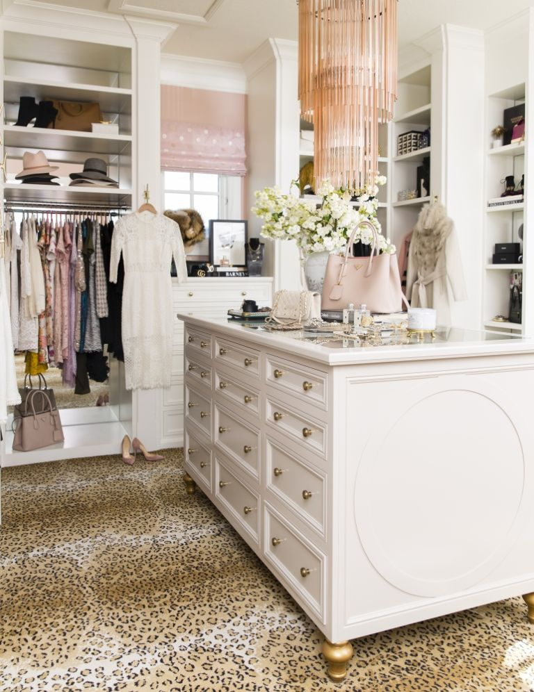 """Blogger  Rachel Parcell 's closet was first designed three years ago. Working with Jessica Bennett of Alice Lane Home Collection, the concept for the overall design began with a few favorite things from Parcell's closet. """"I remember I pulled out a light pink polka dot blouse and that's kind of what inspired the roman shades,"""" Parcell says. """"But out of everything I pulled out, the most I had was leopard."""" What resulted is a beautiful space with both elements of feminine prettiness and a bit of edge, or as we like to call it,  rock and refined ."""