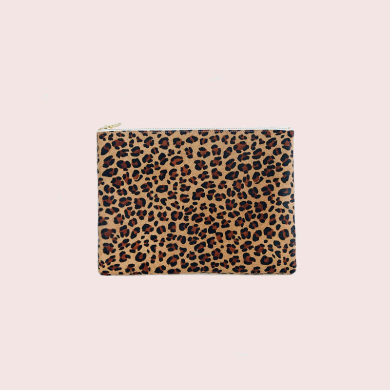 The Saint-Tropez Zip Pouch in eternally chic leopard: use it as a clutch with a ruffled little white dress and espadrilles for summer nights, or as a travel case for bottles of lotions and perfume or as a pencil case at the office ...   + shop now
