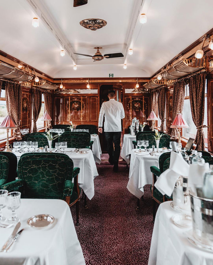 """Three elegant dining carriages exude culinary sophistication, from Lalique glass inlays in Cote d'Azur to black lacquer panels in L'Oriental. The Bar Car glows with a champagne sparkle while the resident pianist fills the air with sweet melodies."" -- Venice Simplon-Orient-Express"