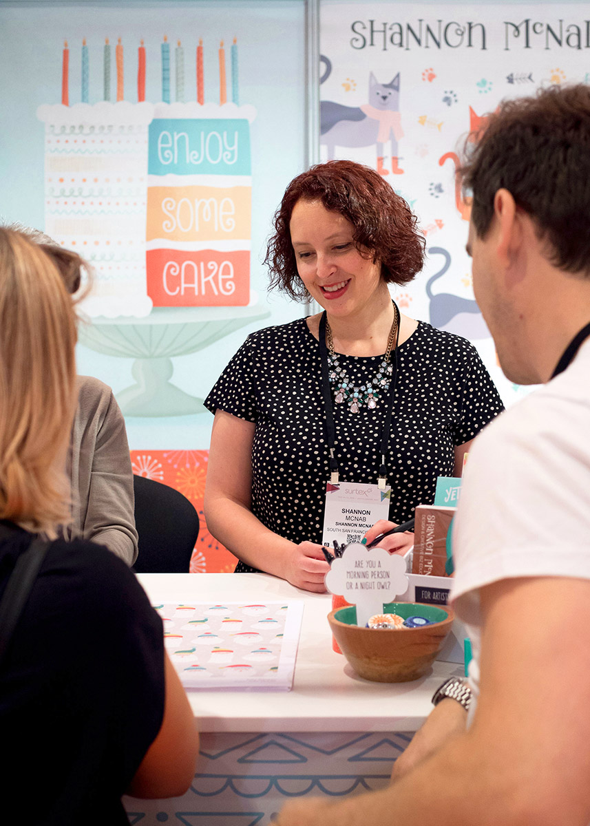 Chatting with potential clients in my booth | Photo courtesy of @surtexshow