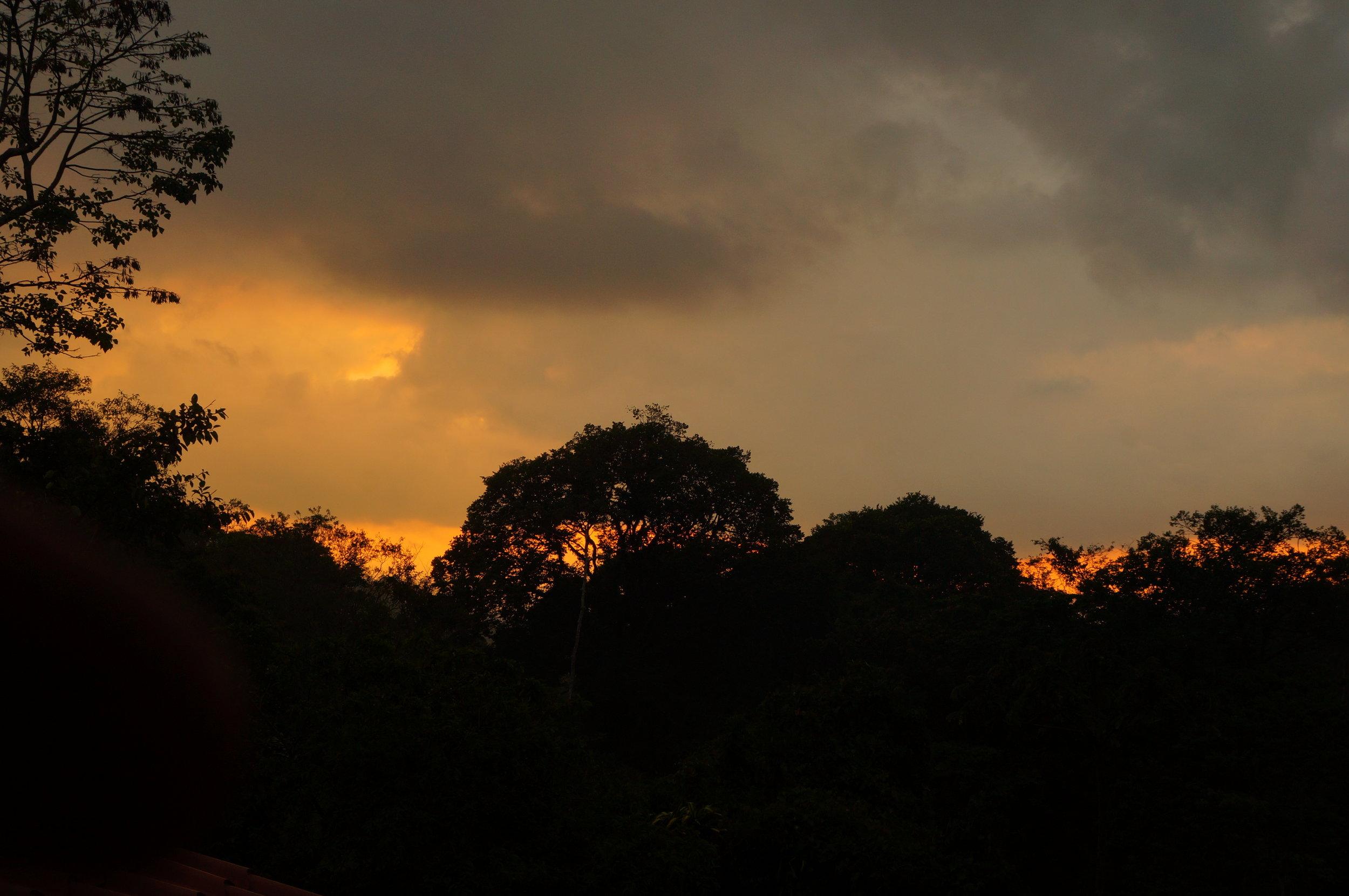 Sun setting over the mountains, in San Jose Costa Rica