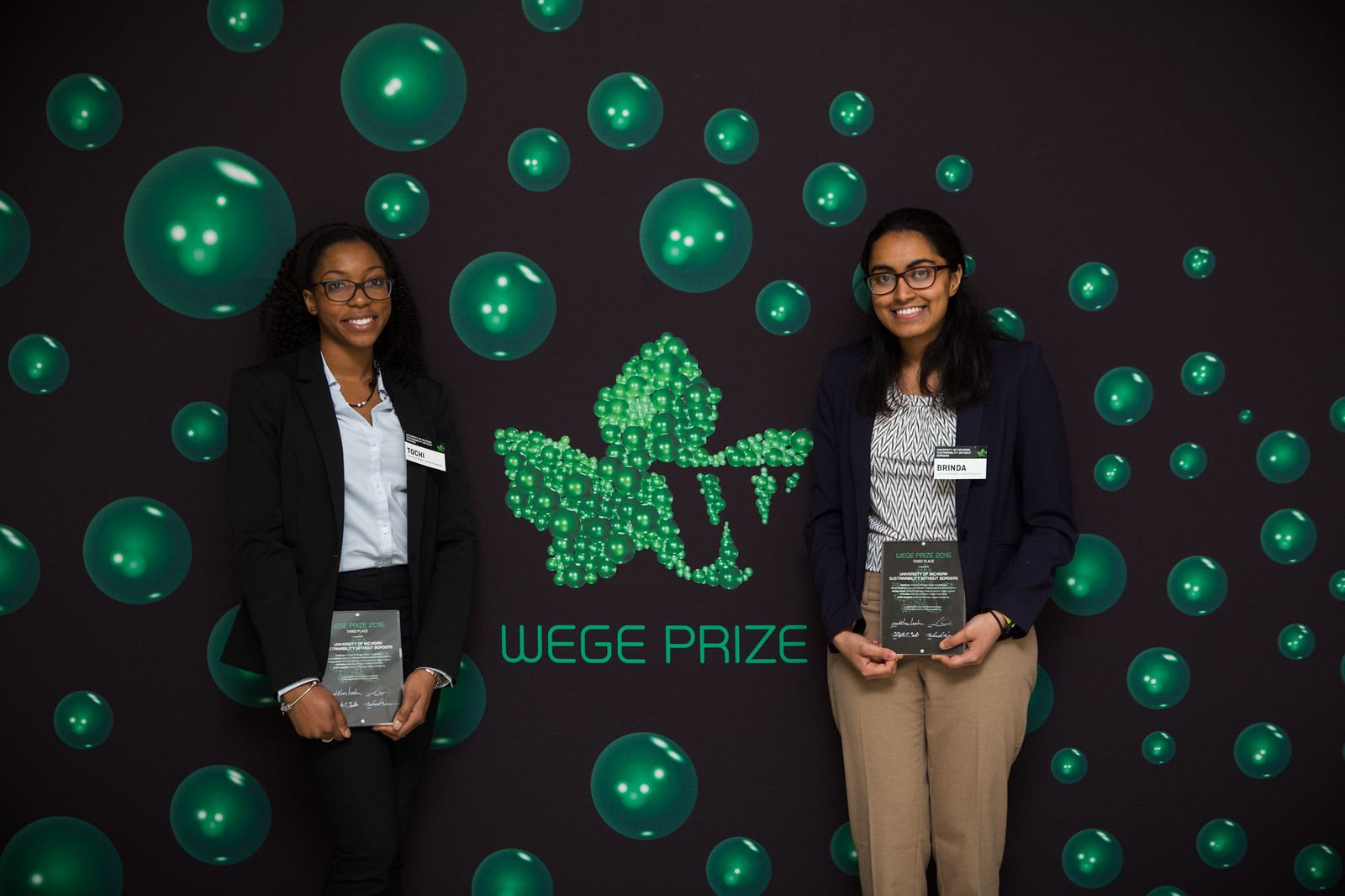 University of Michigan Sustainability Without Borders members Tochi Nwogu (left) and Brinda Yarlagadda (right) with their 3rd place trophies at the Wege Prize 2016 Awards