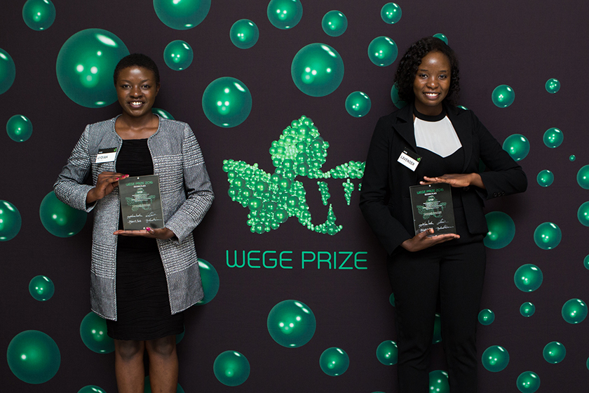 KYCE team members Lydiah Mpyisi (left) and Lavender Micalo (right) with their 2nd place trophies at the Wege Prize 2016 Awards