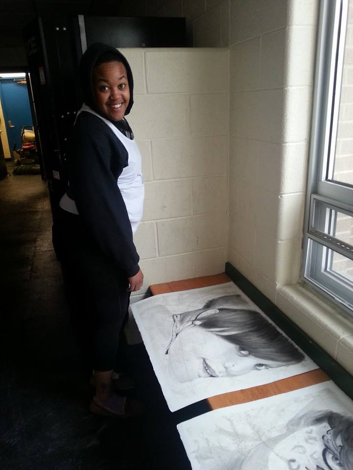 Michelle O'BombYa sees her portrait for the first time