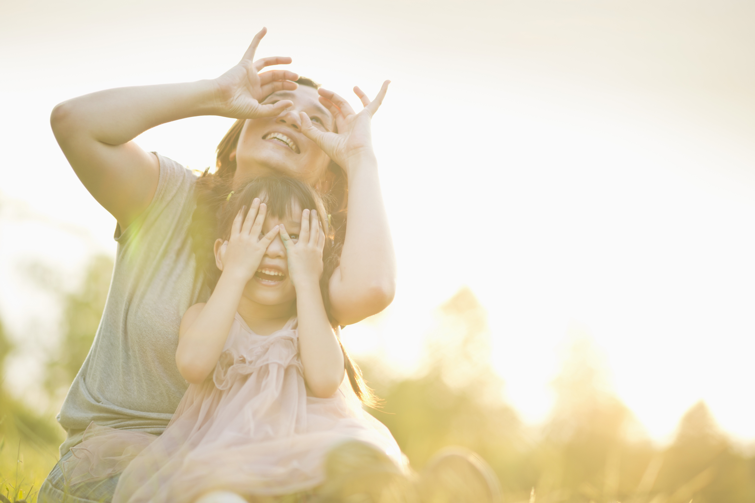 mother-and-child-playing-under-sunset-1.jpg
