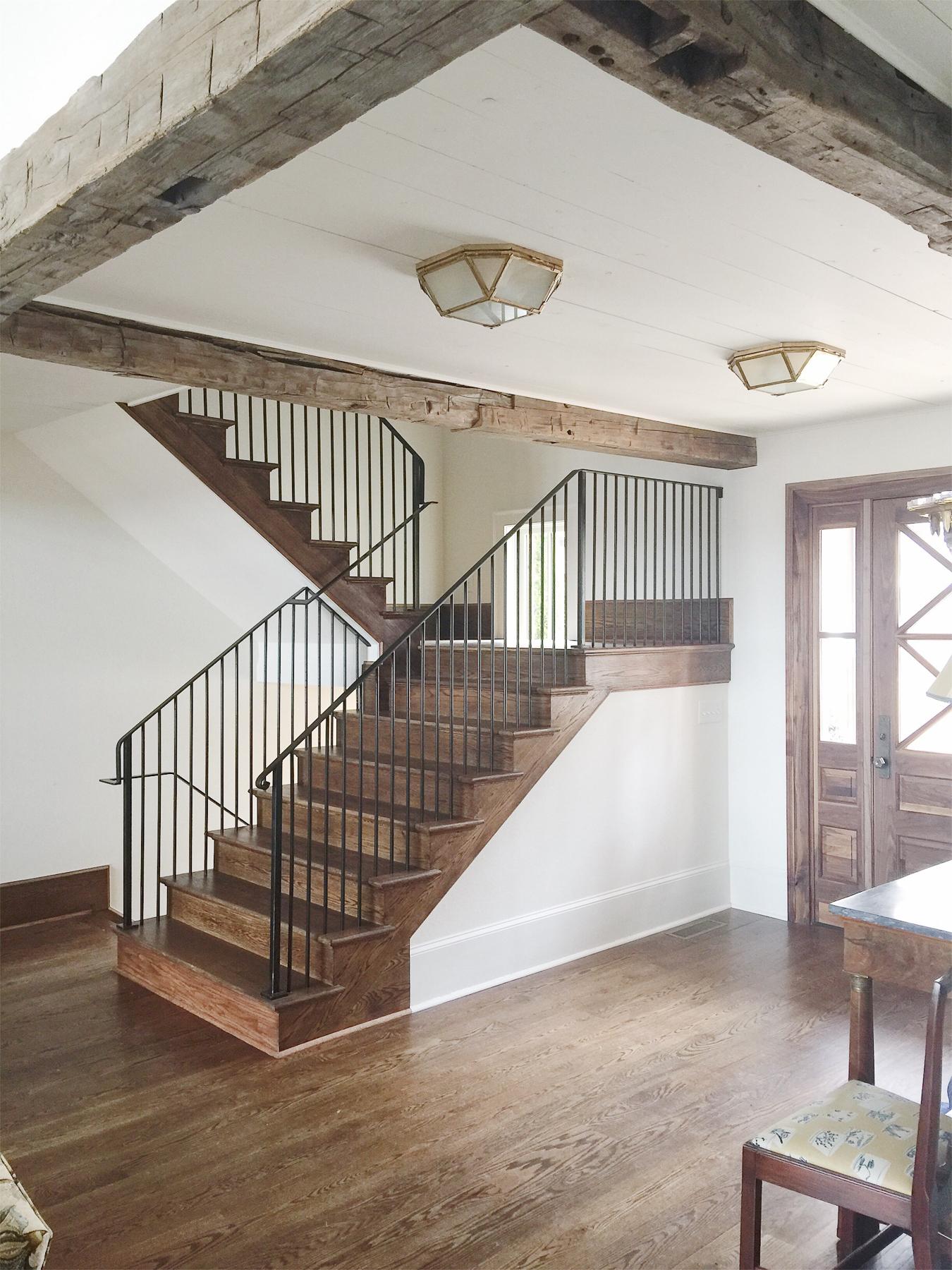 lakehouse custom railing reclaimed beams.jpg