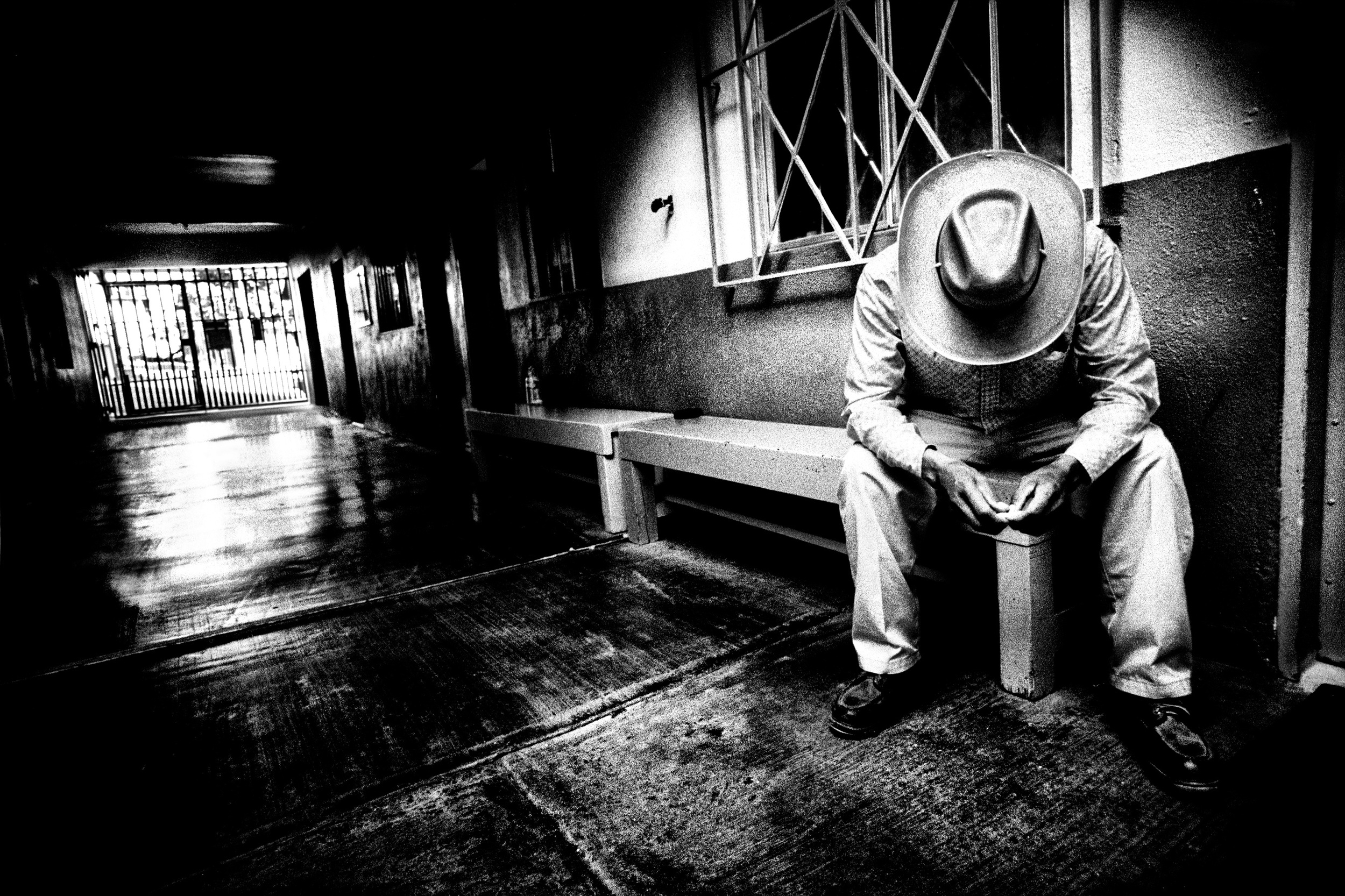 An unidentified man sits at the Casa del Migrante, a migrant shelter in Tijuana, Mexico.