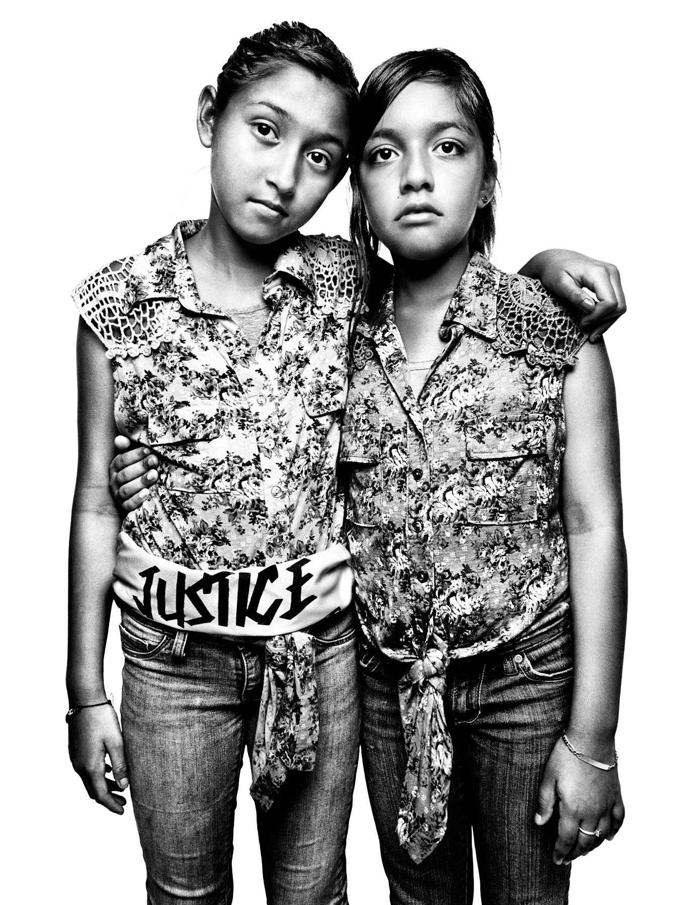 Jacqueline Rayos (R), and Mayra Lovatos, both 11, are cousins and US citizens. But Jacqueline's mother and Mayra's aunt, Guadalupe Garcia de Rayos, is undocumented. She was arrested in 2008 in a raid conducted by Sheriff Joe Arpaio of Maricopa County and eventually put into deportation proceedings. After a public campaign by the immigrant advocacy group Puente, Guadalupe was granted a one-year stay of removal. Jacqueline and Mayra were photographed after a protest organized by Puente Arizona in front of Immigration and Customs Enforcement headquarters in Phoenix, Arizona, on July 29, 2013, a few days after Guadalupe's stay was granted. On February 8, 2017 -- during her annual appointment with immigration officials -- agents arrested Guadalupe and began procedures to send her back to Mexico, a country she has not seen since she left 21 years ago.