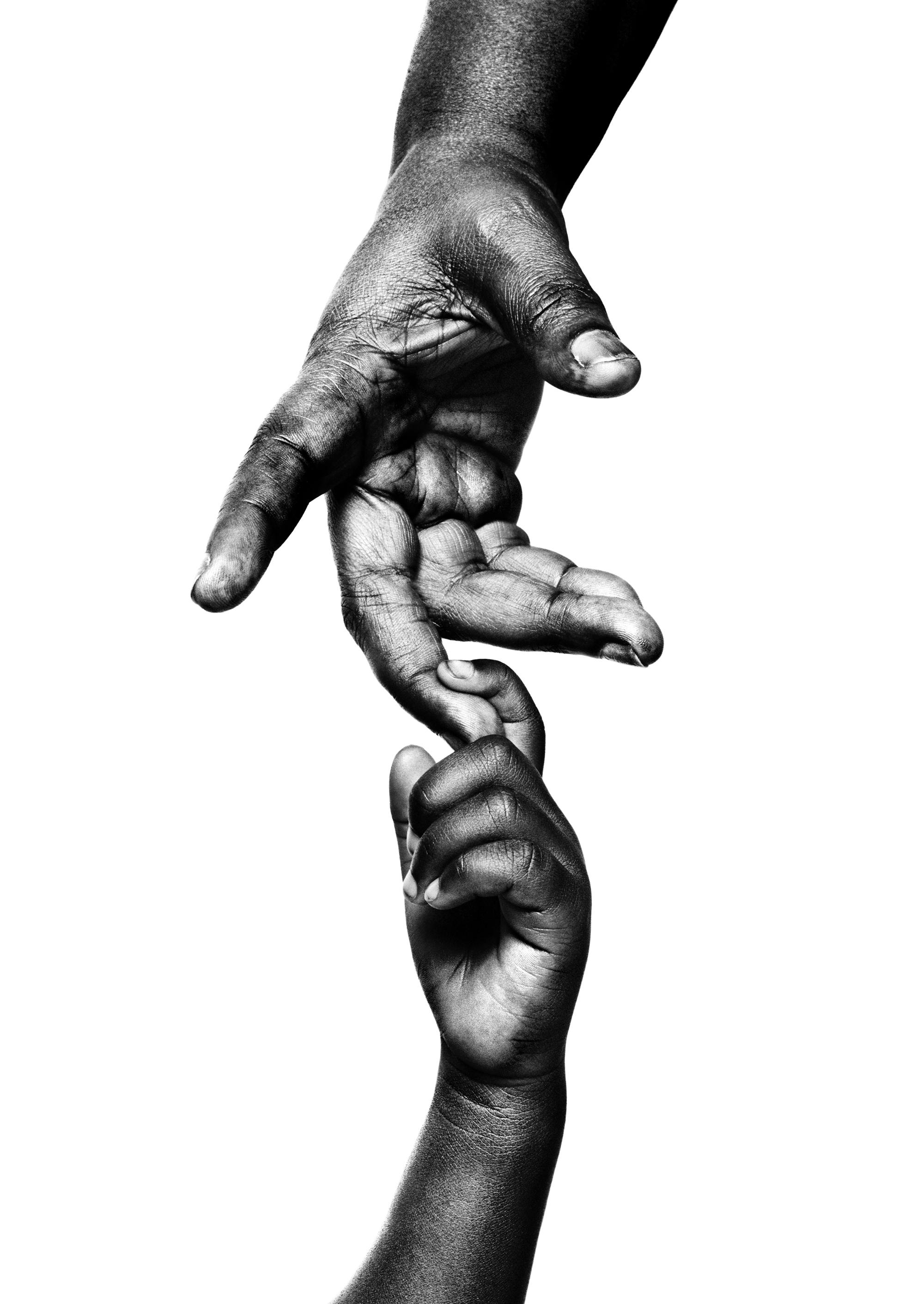 "Hands of ""Mama"" Zawadi Nadintu, 62, and Vanessa, 4"