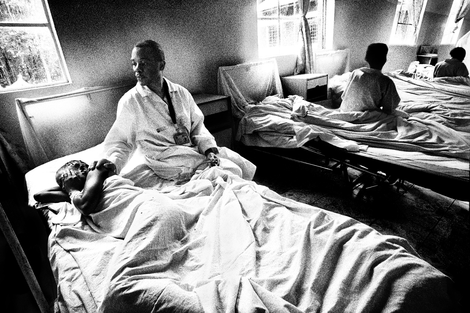 Dr. Patrick Bigabwa comforts a patient at Panzi Hospital.