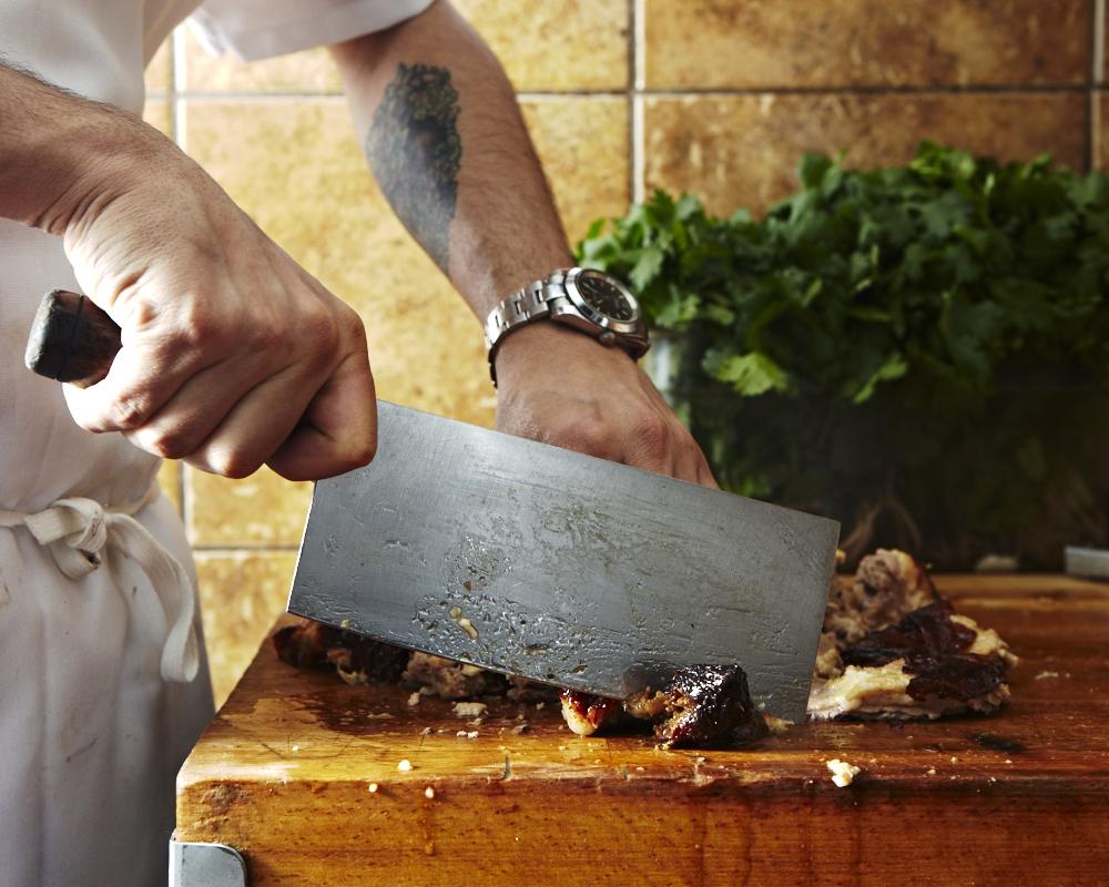Chopping the Peking duck.
