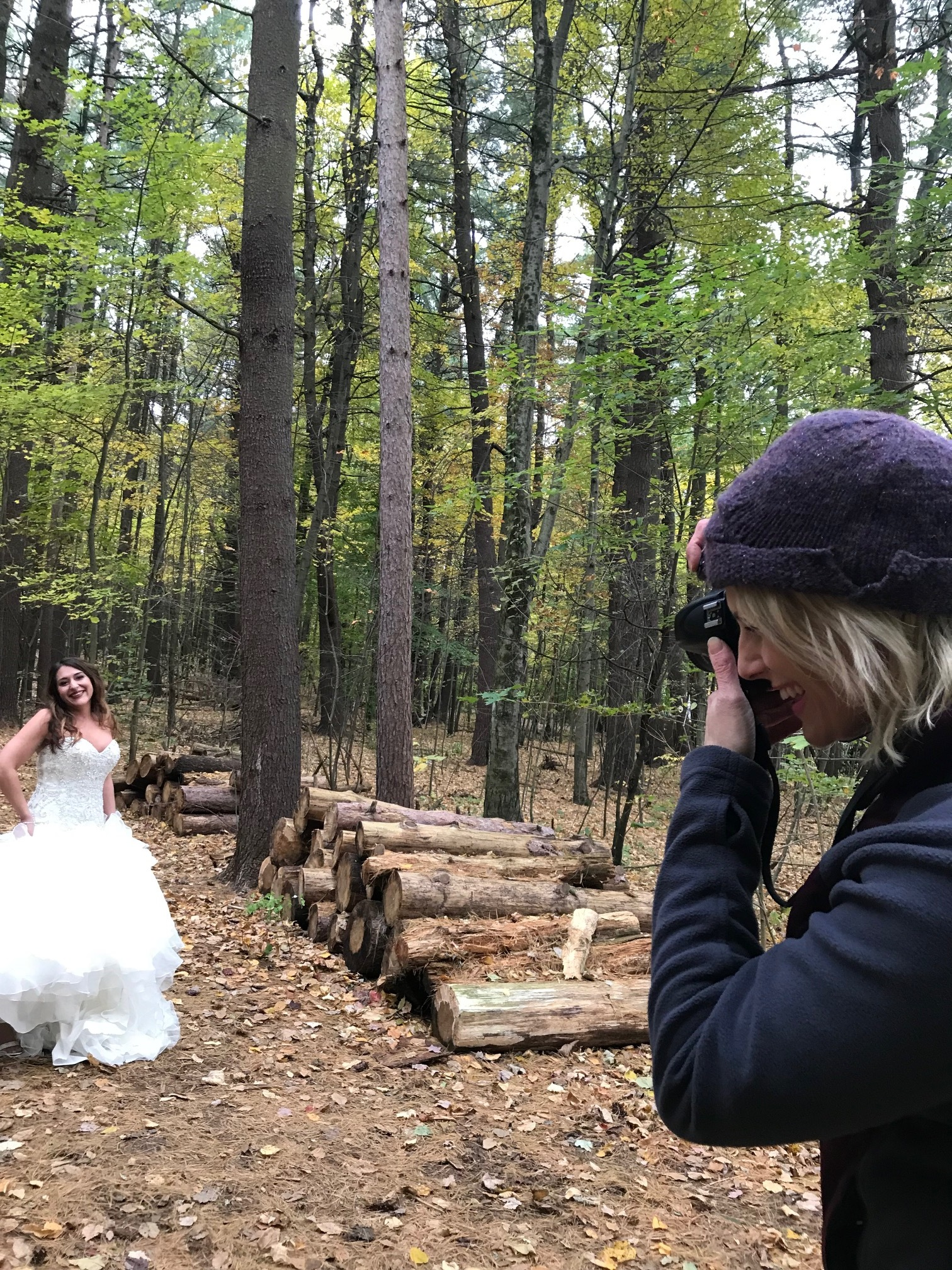 """Photographer Lorraine grabbing shots of our client. A group of hikers with children stopped to say hello as the kids thought she was a """"Fairy in the forest""""!"""