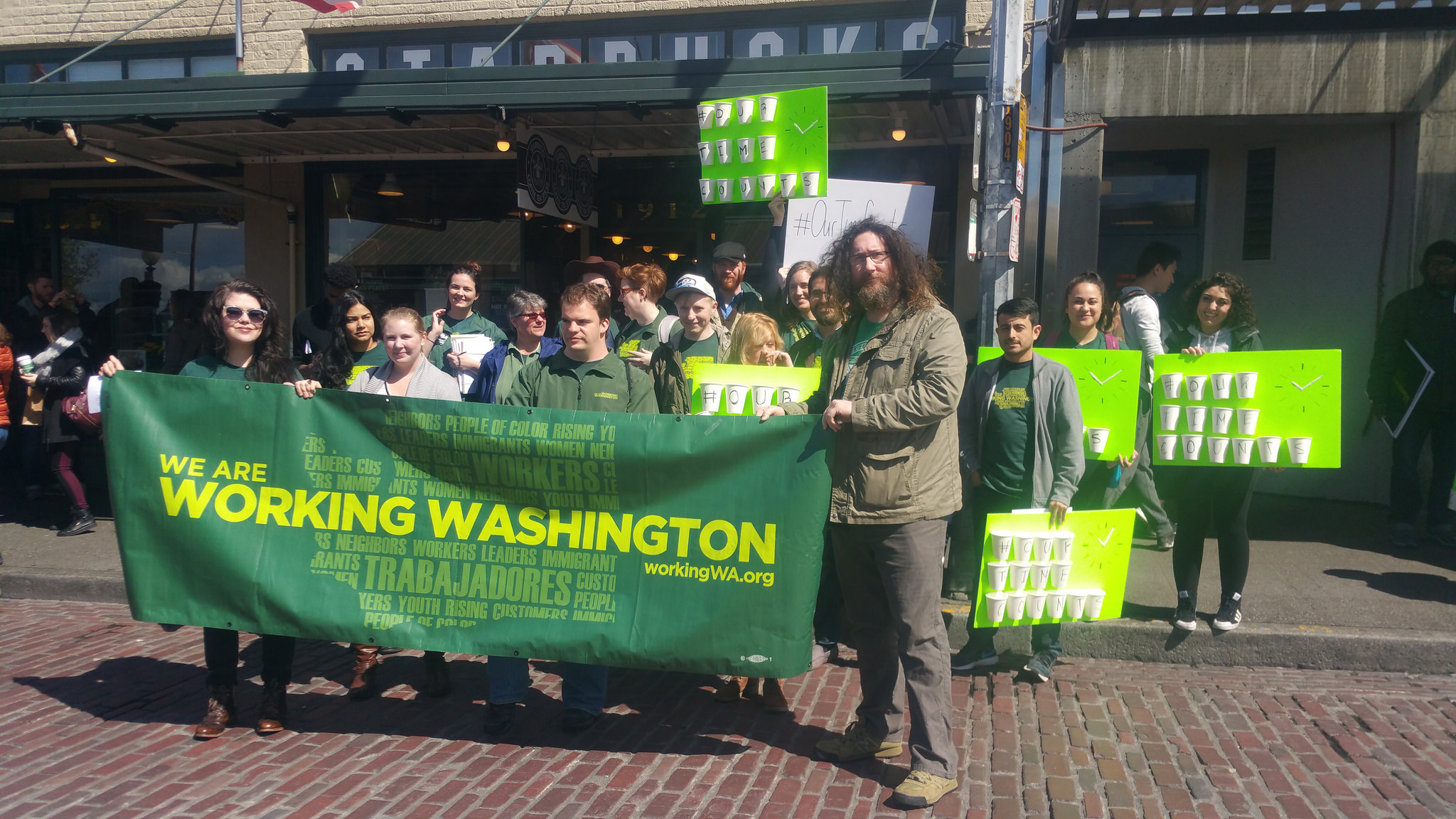 """April 14, 2016: Rally for secure scheduling outside """"Original Starbucks"""" in Pike Place Market, Seattle."""