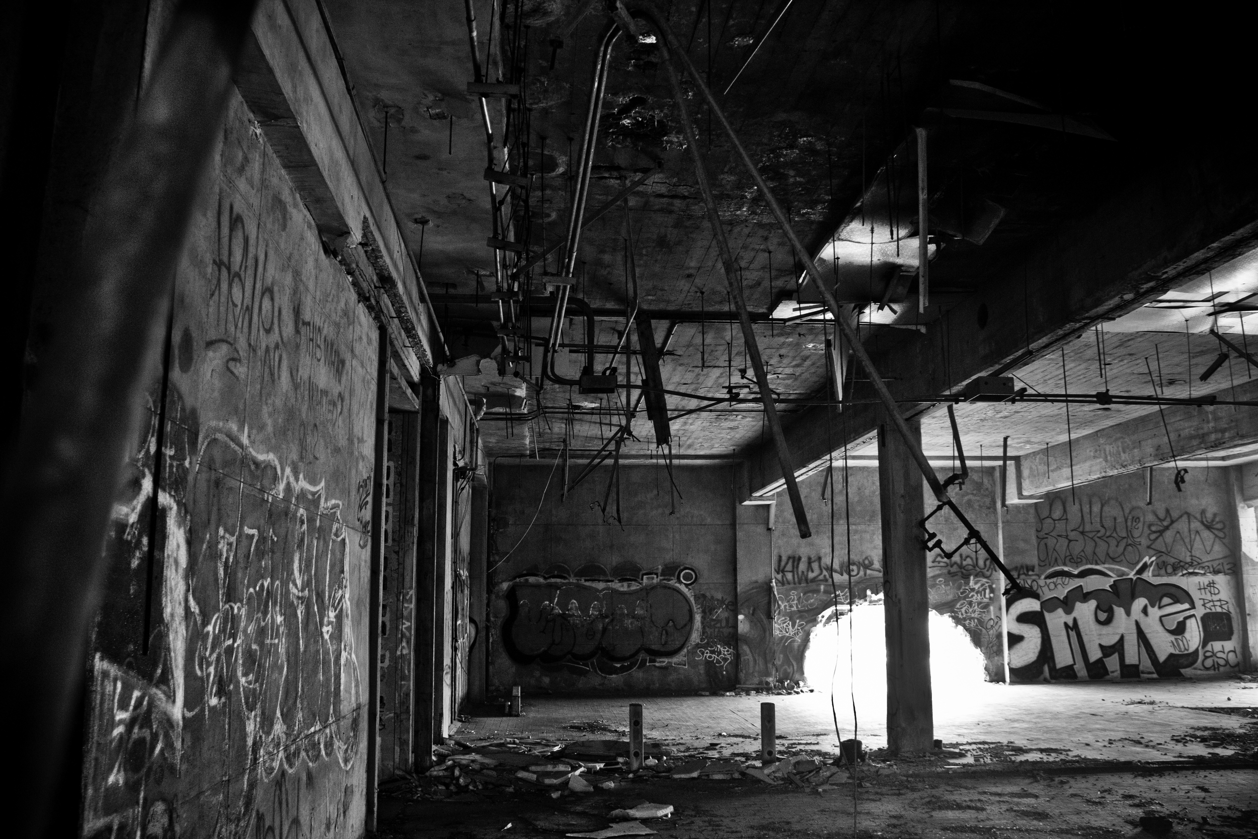 An abandoned warehouse lies gutted, a clear sign that scrappers have been here before.