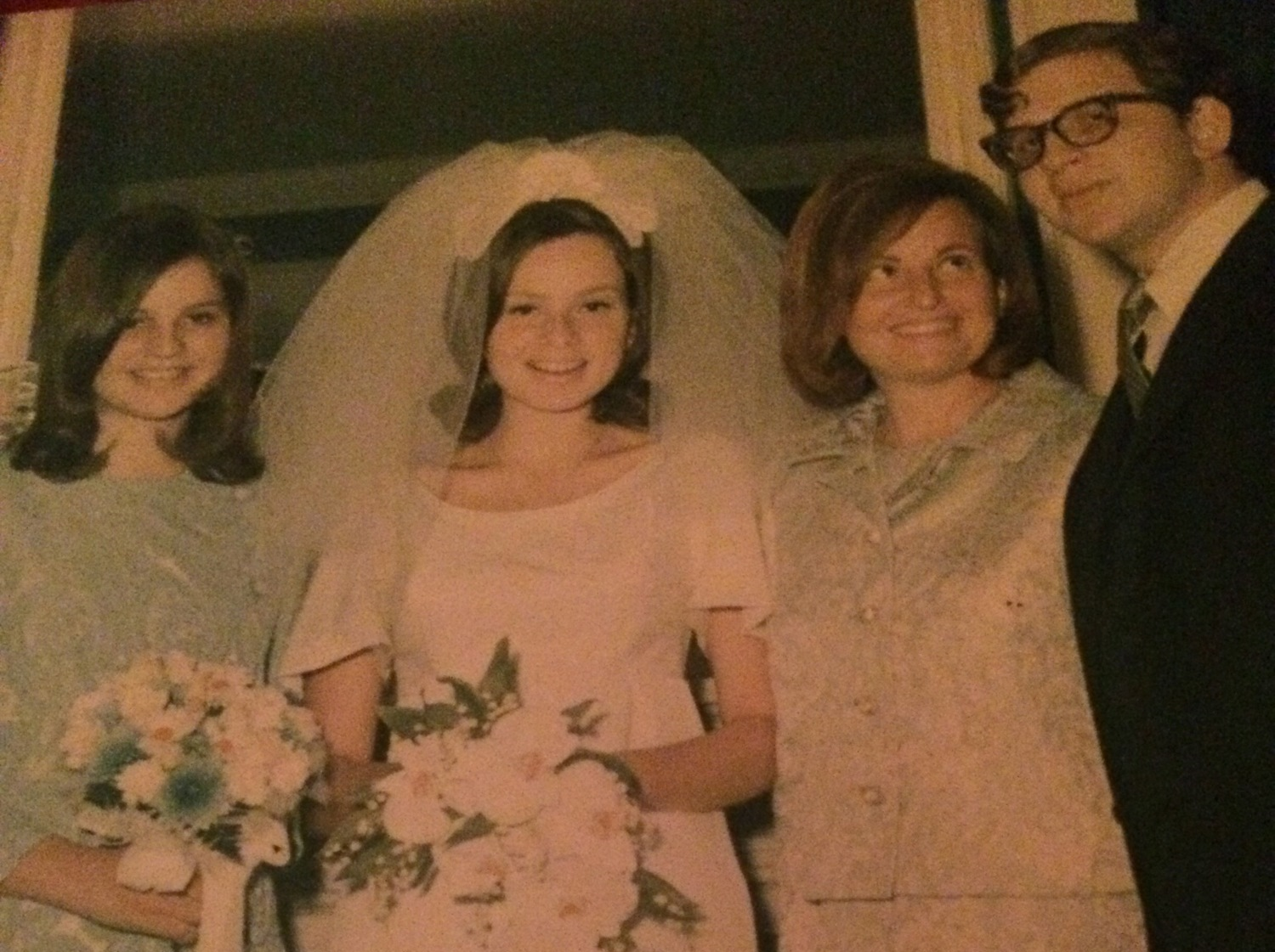 Wendy, Mom, Sandy, Bruce at our parents wedding at the Plaza Hotel in 1967.