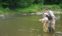 Family fly fishing on the Battenkill River in Manchester Vermont