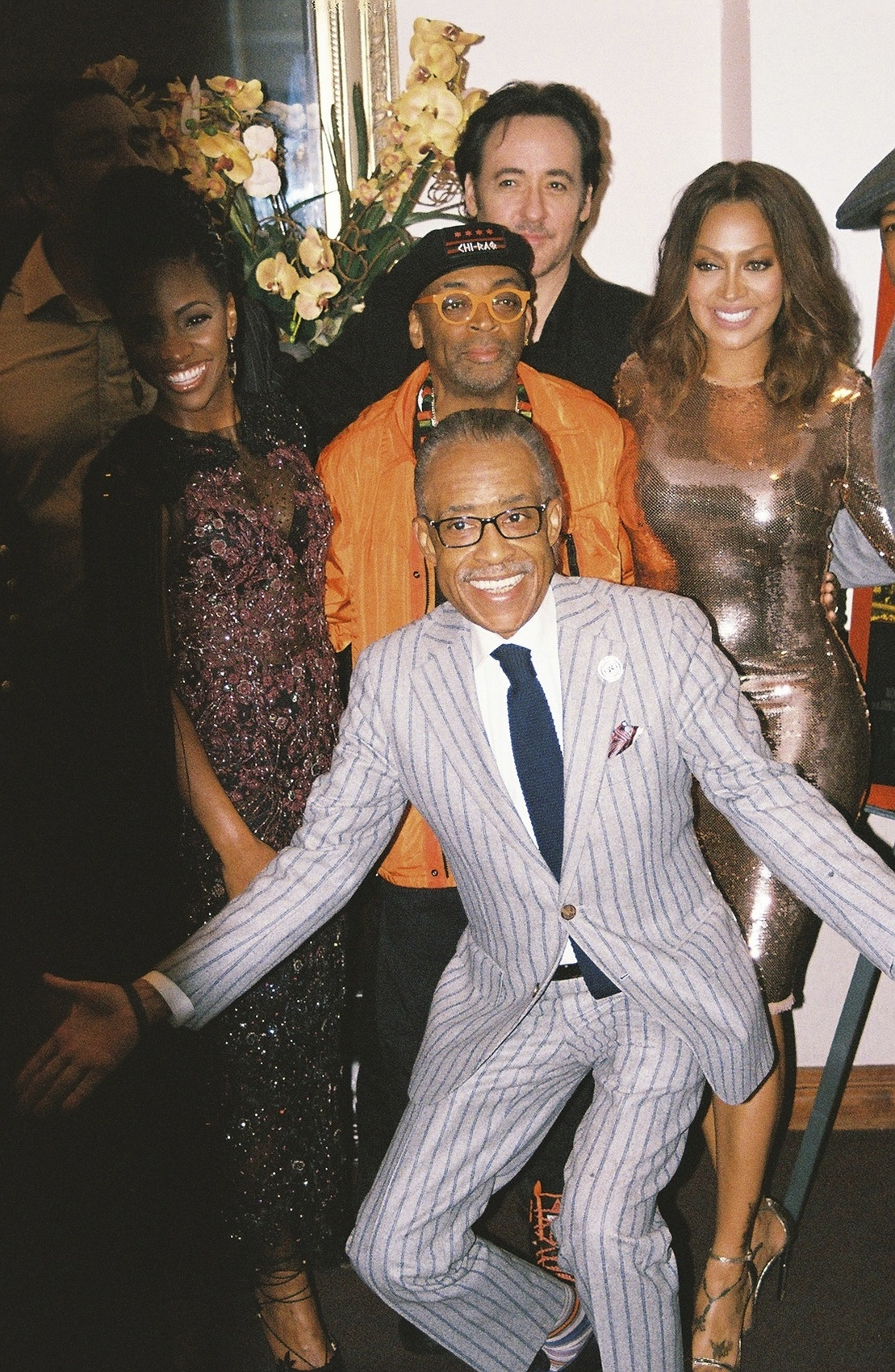 Cast members pose with the Reverend Al Sharpton.