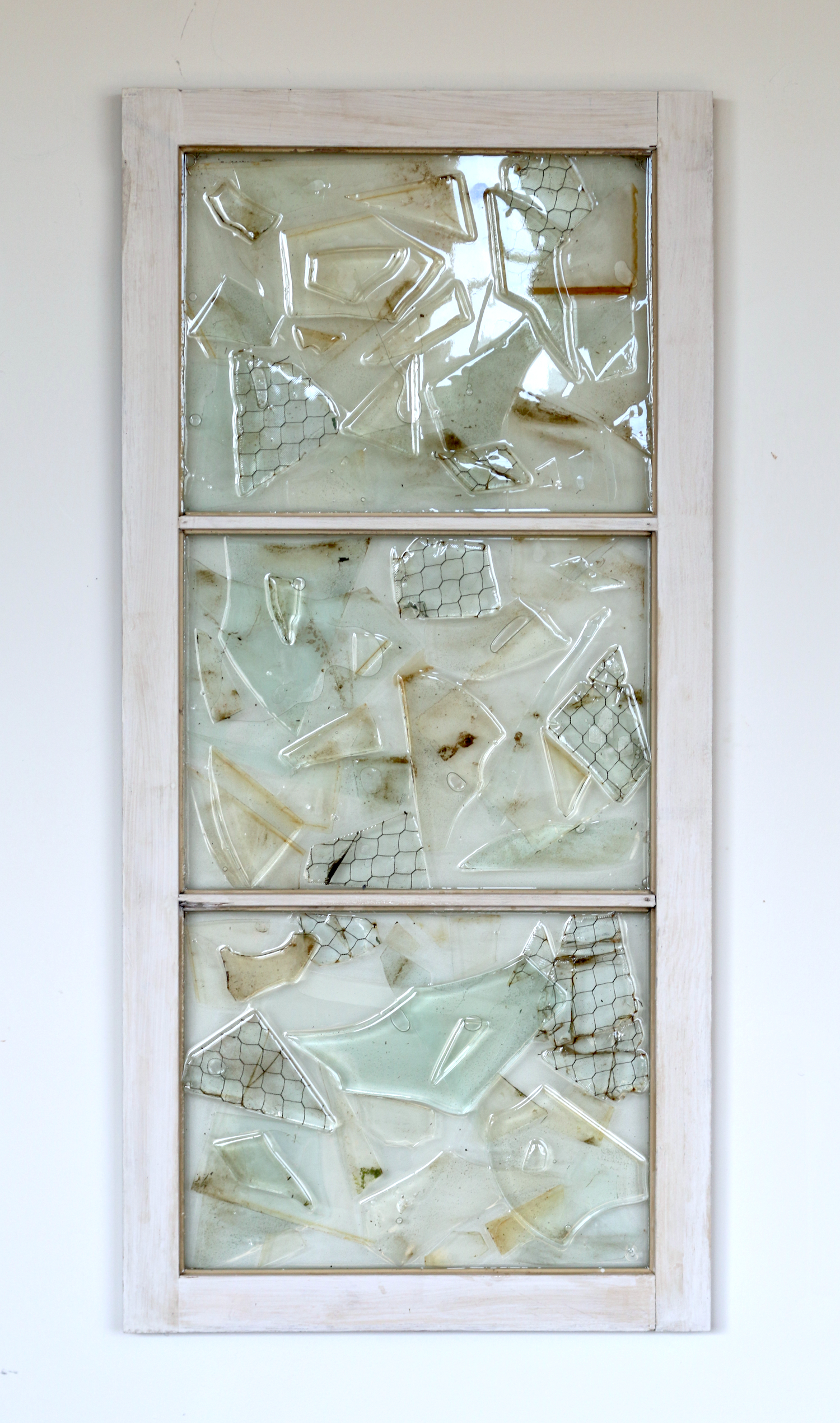 "Clarity is a State of Mind , found glass, window, resin, 24""x45"", 2015."