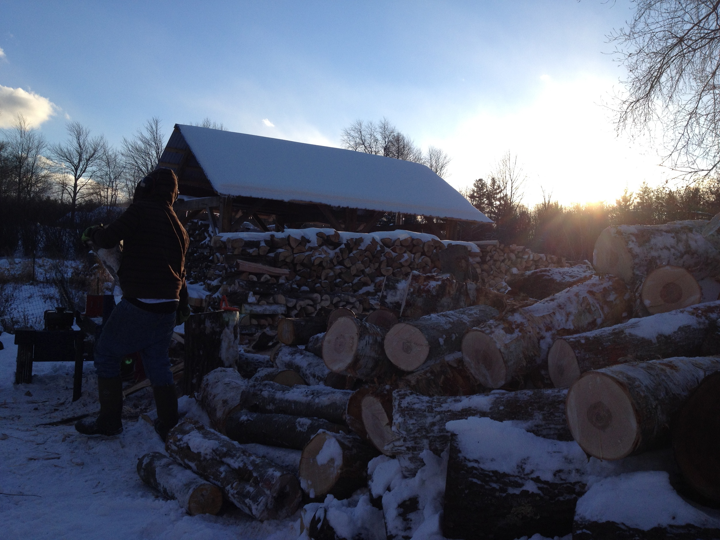 Splittin' and stackin' cordwood til the sun goes down.