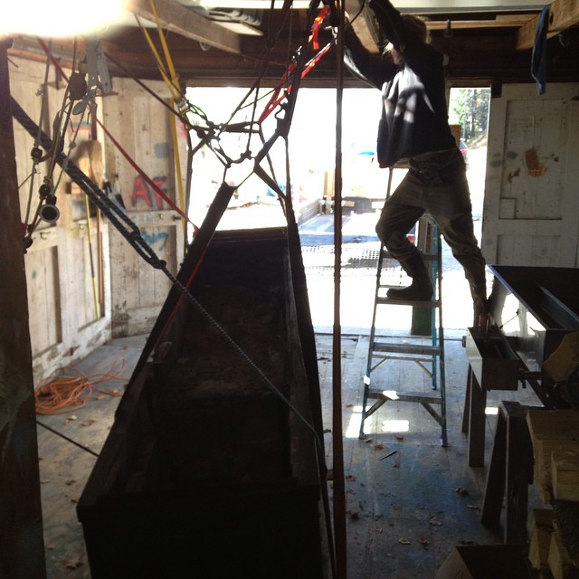 Sugar prep: Installing the ridiculously heavycast-iron maple sap evaporator.