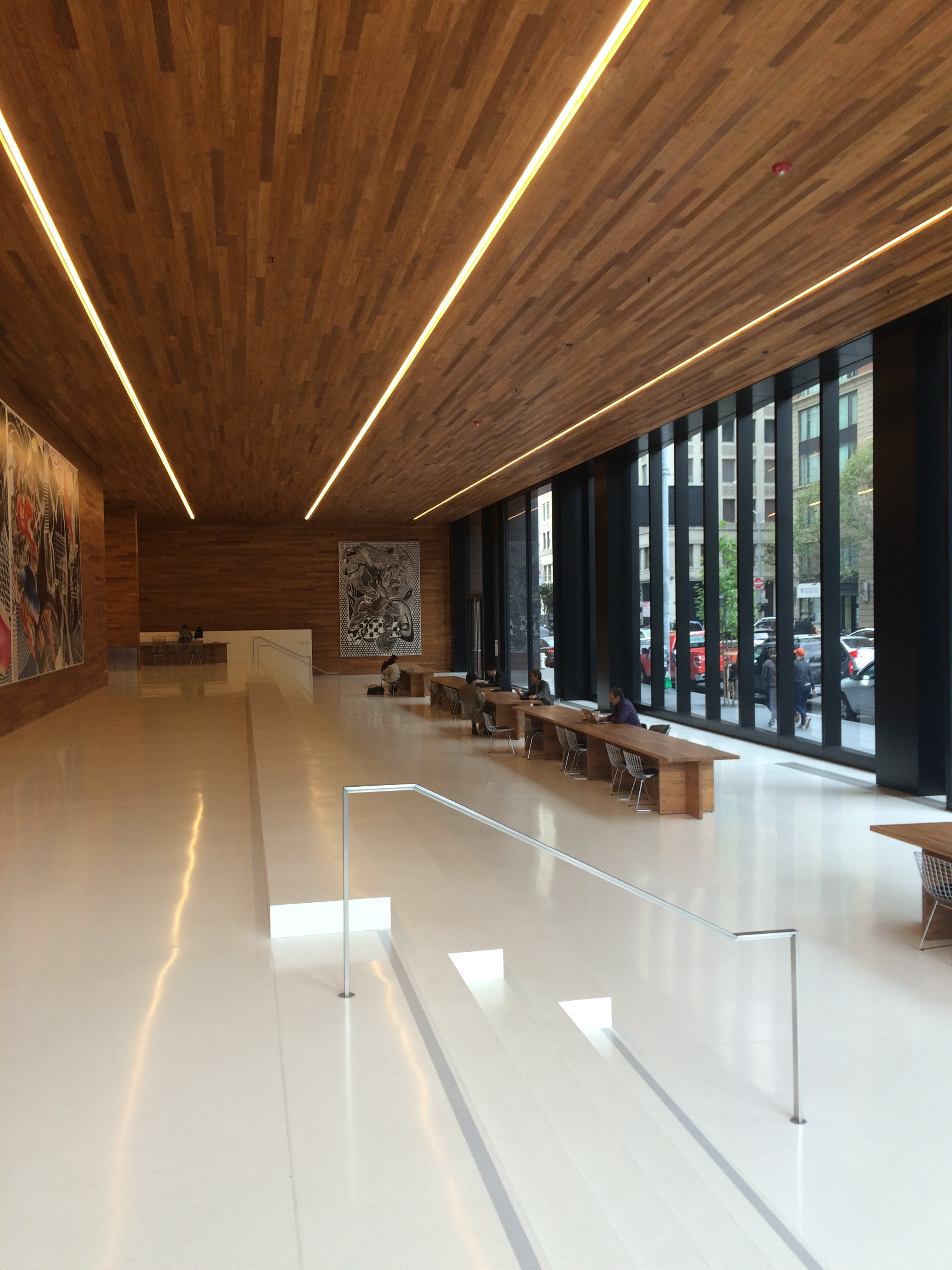 the building has a massive open public space with tables chairs and lots of fresh air!