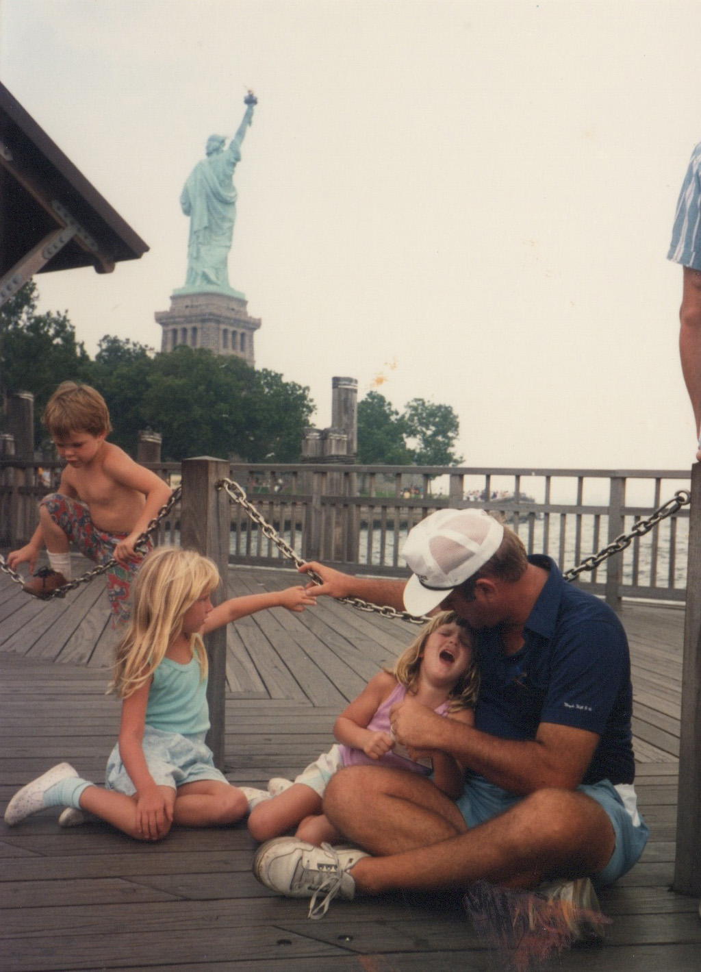 Liberty Island, waiting for the ferry with my father and  fussy sister . August 6, 1989