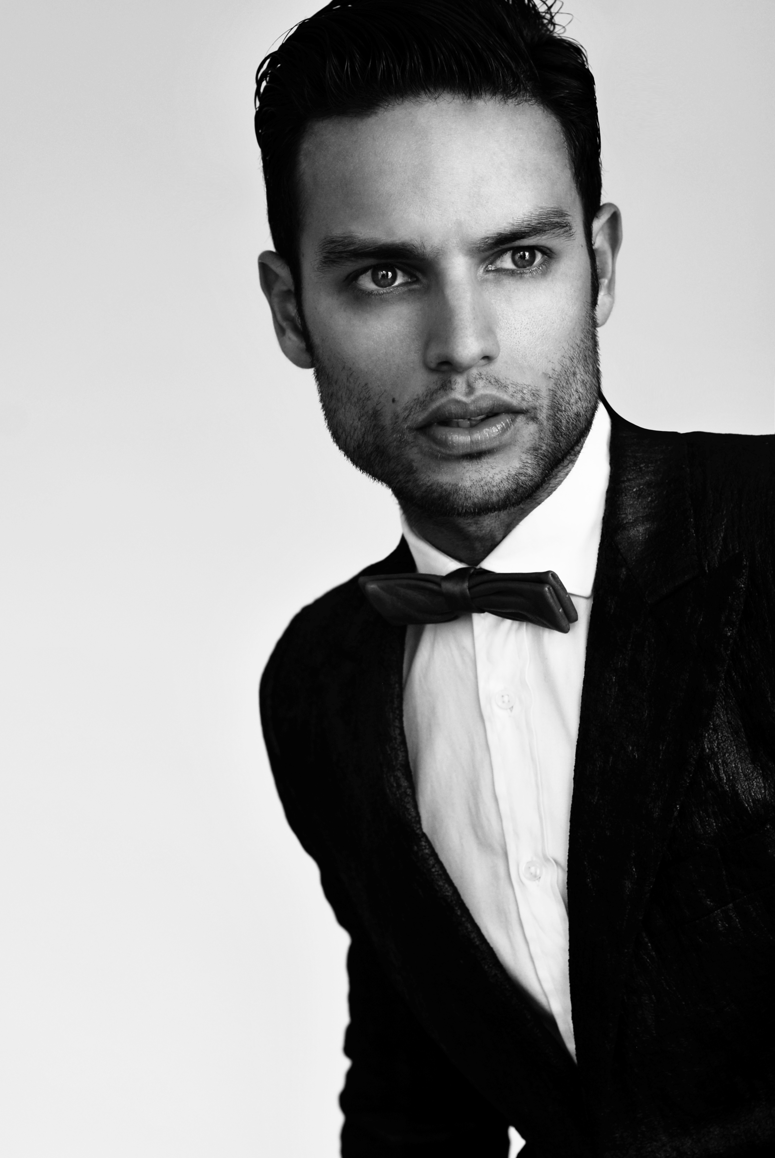 Alexis wears a suit and shirt by Simon Spurr and bow-tie by Timo Weiland.