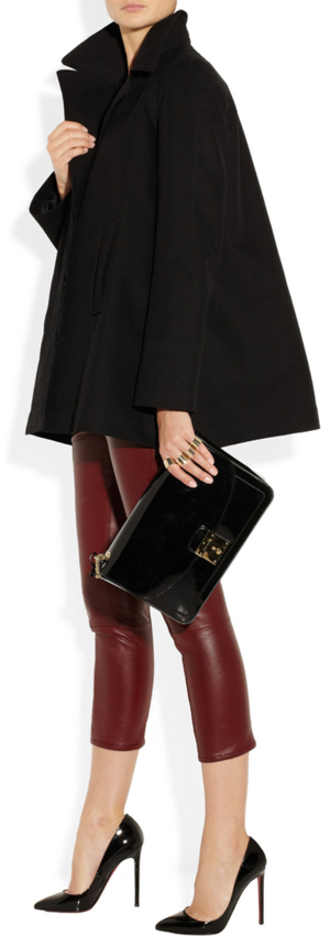 Coat by The Row, leggings by The Row, bag by Marc Jacobs and pumps by Christian Louboutin and rings by Maison Martin Margiela.
