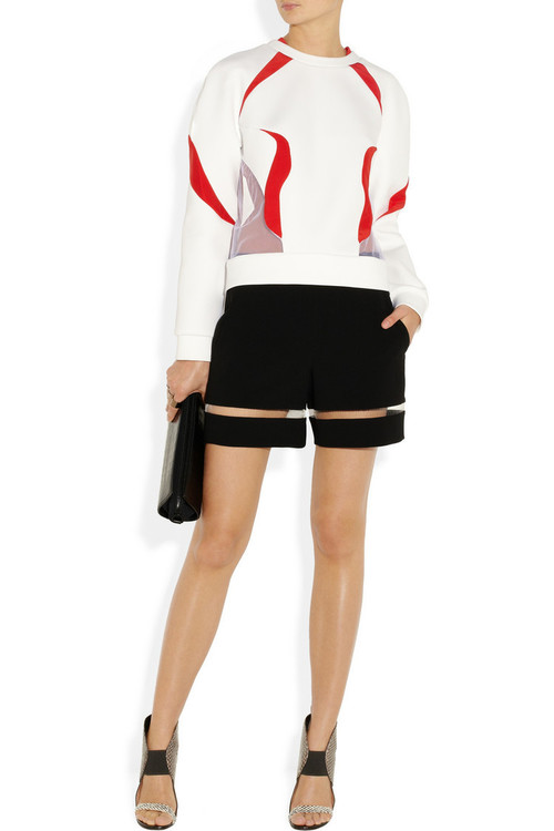 Top by Prabal Garung, shorts and clutch by Alexander Wang, shoes by Roland Mouret and rings by Maison Martin Margiela.