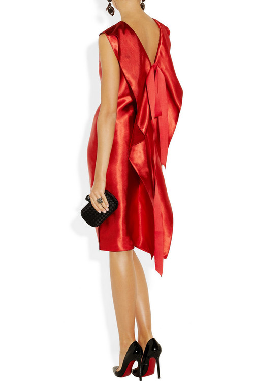 Dress, earrings, and ring by Lanvin, clutch by Bottega Veneta and pumps by Christian Louboutin.