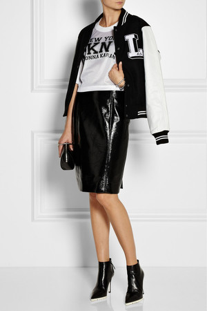 Bomber jacket by Lulu & Co., shirt by DKNY, skirts by Jonathan Saunders, boots by Miu Miu, bag by Alexander Wang and bracelets by Eddie Borgo.