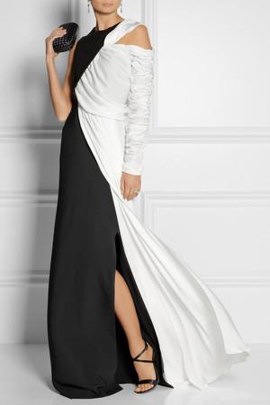 Gown by Vionnet, sandals by Gianvito Rossi, clutch by Bottega Veneta, ring by Alexander McQueen and earrings by Tom Binns.