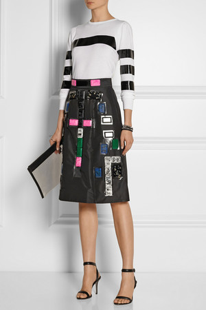 Shirt and skirt by Toga, sandals by Alexander Wang and clutch by Jil Sander.