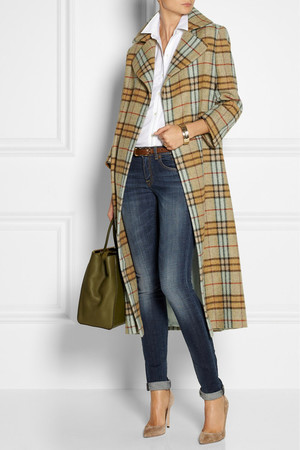 Coat by Emilia Wickstead, shirt by Theory, jeans by Rag & Bone, shoes by Gianvito Rossi, bag by Fendi and bracelet by Mulberry.