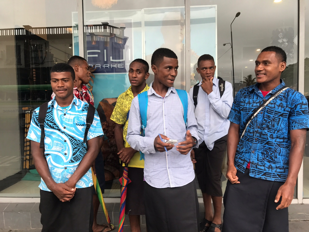 Young teenage boys after they helped us cross a busy street in Suva.