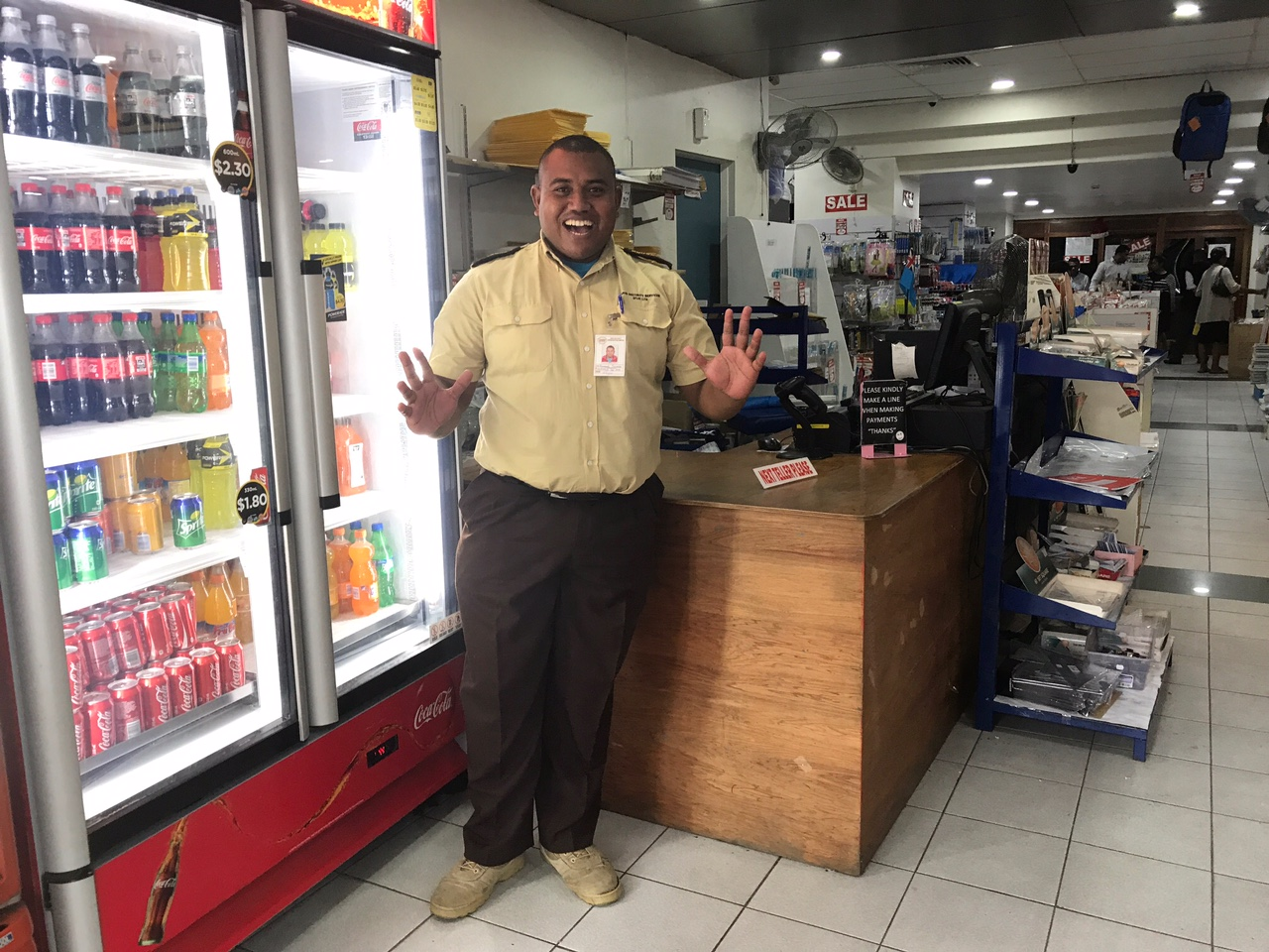 """The security guard at the post office. You'll notice that when I take photos of people their mouths are open. This is because instead of cheese, they are saying """"Bula!"""""""