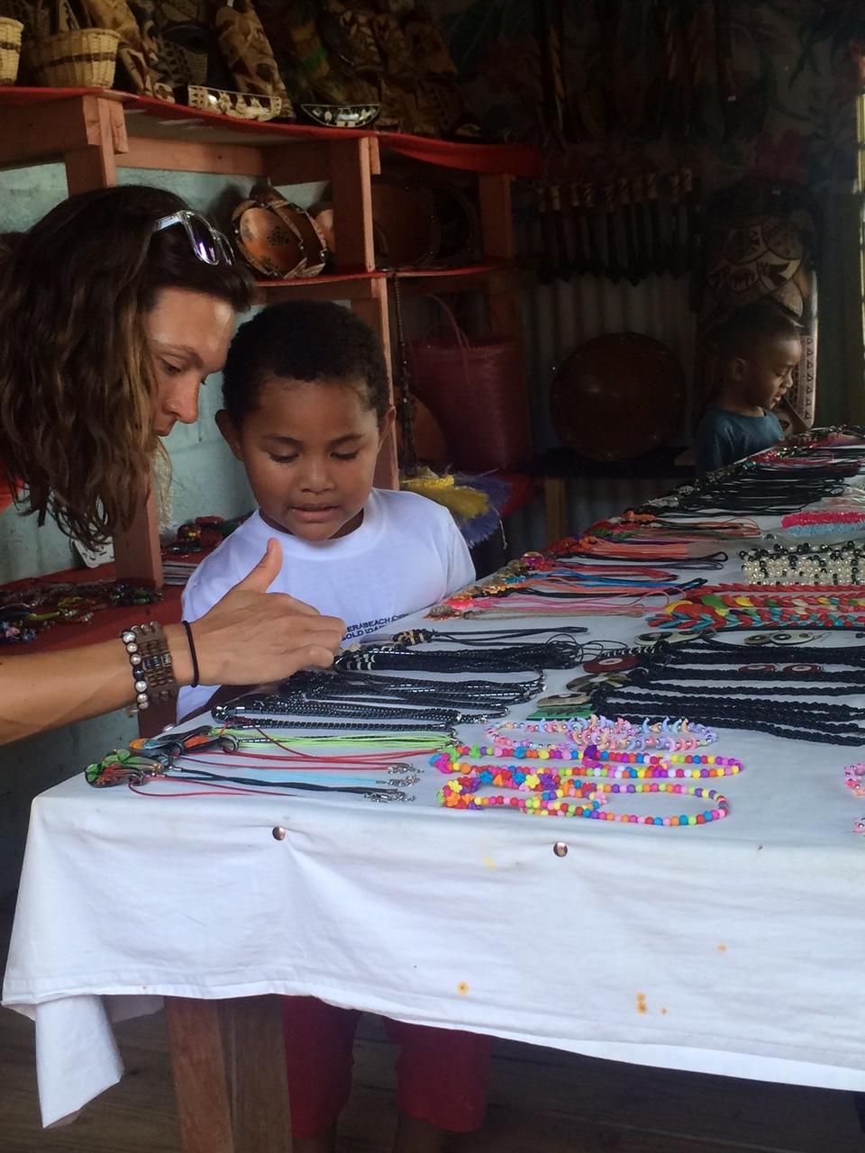 Learning Fijian from a local boy.
